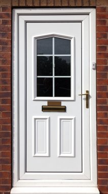 White front door in a red brick building