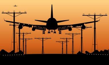 Airliner landing at sunset