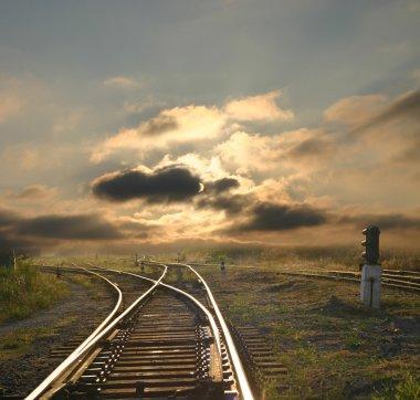 Evening landscape with railroad rails