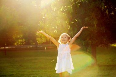 Girl playing in the sun