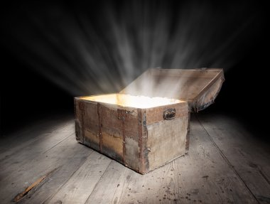 Ancient wooden treasure chest with the strong glow from inside. stock vector