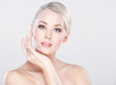 Young beautiful caucasian woman with natural makeup posing in the studio stock vector