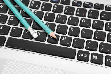 Pencils on a keyboard
