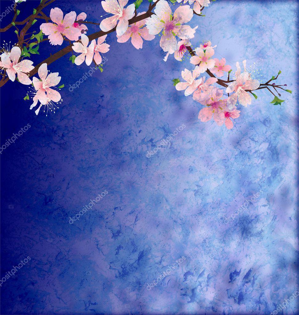 Pink cherry blossom branch on dark blue grunge background easte