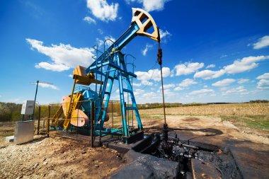 Oil pump under blue sky