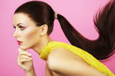 Fashion photo of beautiful woman with ponytail