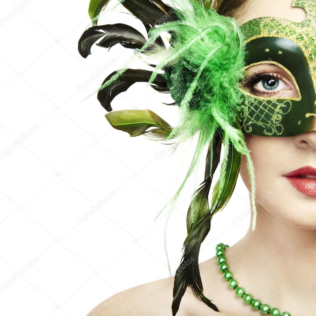 The beautiful young woman in a green venetian mask