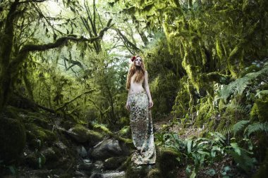 Portrait of romantic woman in fairy forest