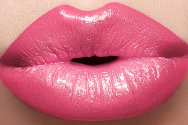 Sweet kiss. Sexy pink wet lip makeup. Close-up of beautiful full lips
