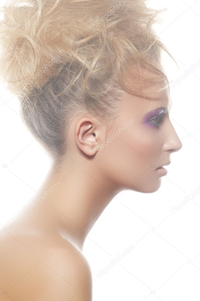 Wellness, spa portrait. Sensual profile of young woman model with big curly bun hairstyle, beautiful neck on white backgound. Natural white light mist