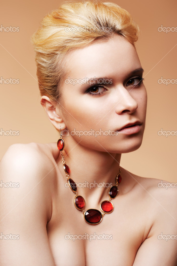 Beauty, fashion and personal accessories. Luxury sexy woman model with natural beige make-up, elegant hairstyle and chic jewelry