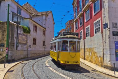 Historic yellow tram in old city of Lisbon, Portugal