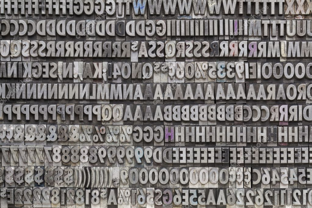 background of letters numbers and punctuation symbols in old grunge metal movable typeset photo by pixelsaway
