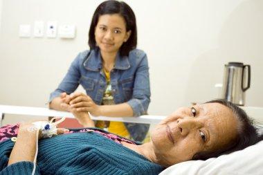 Ethnic granddaughter visit hospitalized sick grandmother