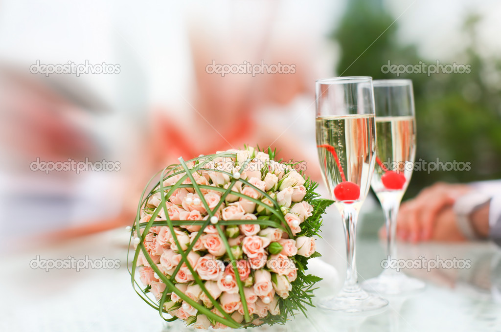 Luxury wedding bouquet of roses with champagne