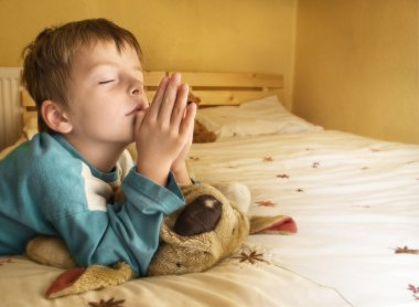 Little boy praying.