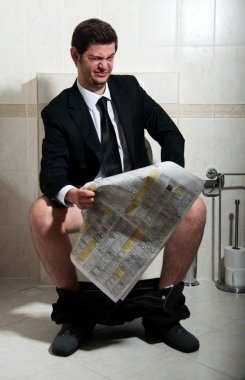 Young businessman at the toilet