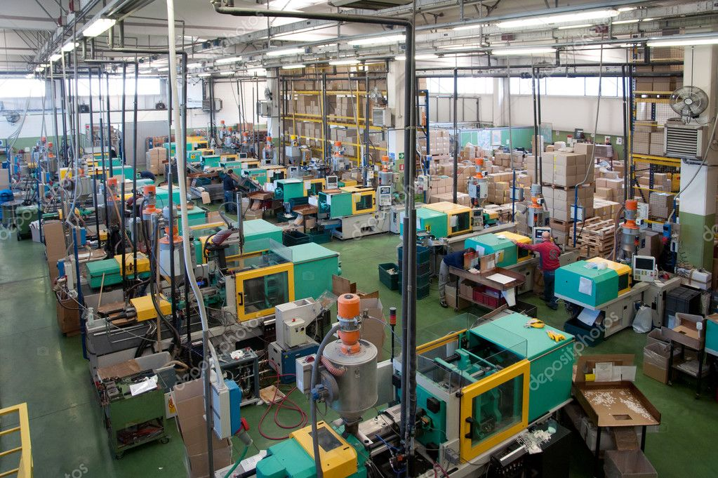 Injection Molding Machines In A Large Factory Stock