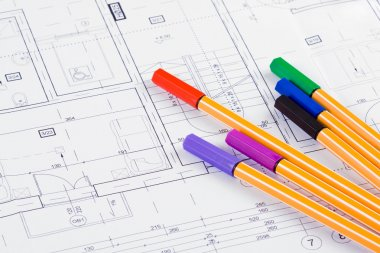 Colored fineliners on architectural project background stock vector