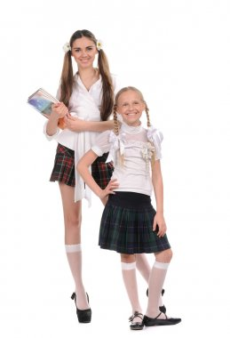 Funny schoolgirls with books in the hand