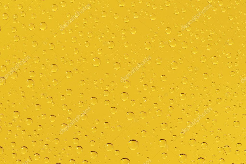 Many water drops on the yellow background