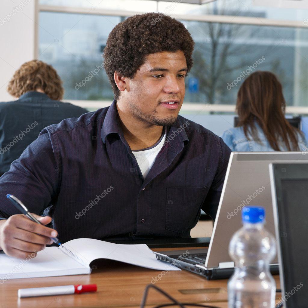 Student behind laptop
