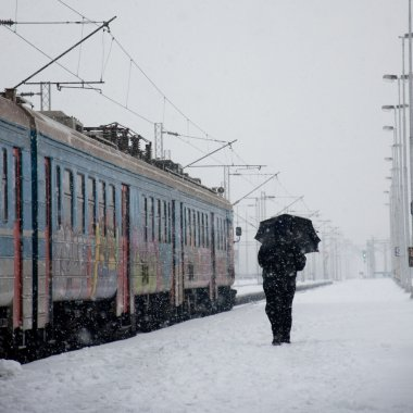Snowing on a train station