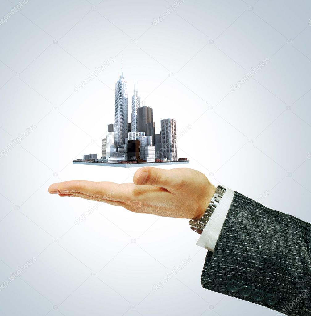 Business city center in businessman's hand