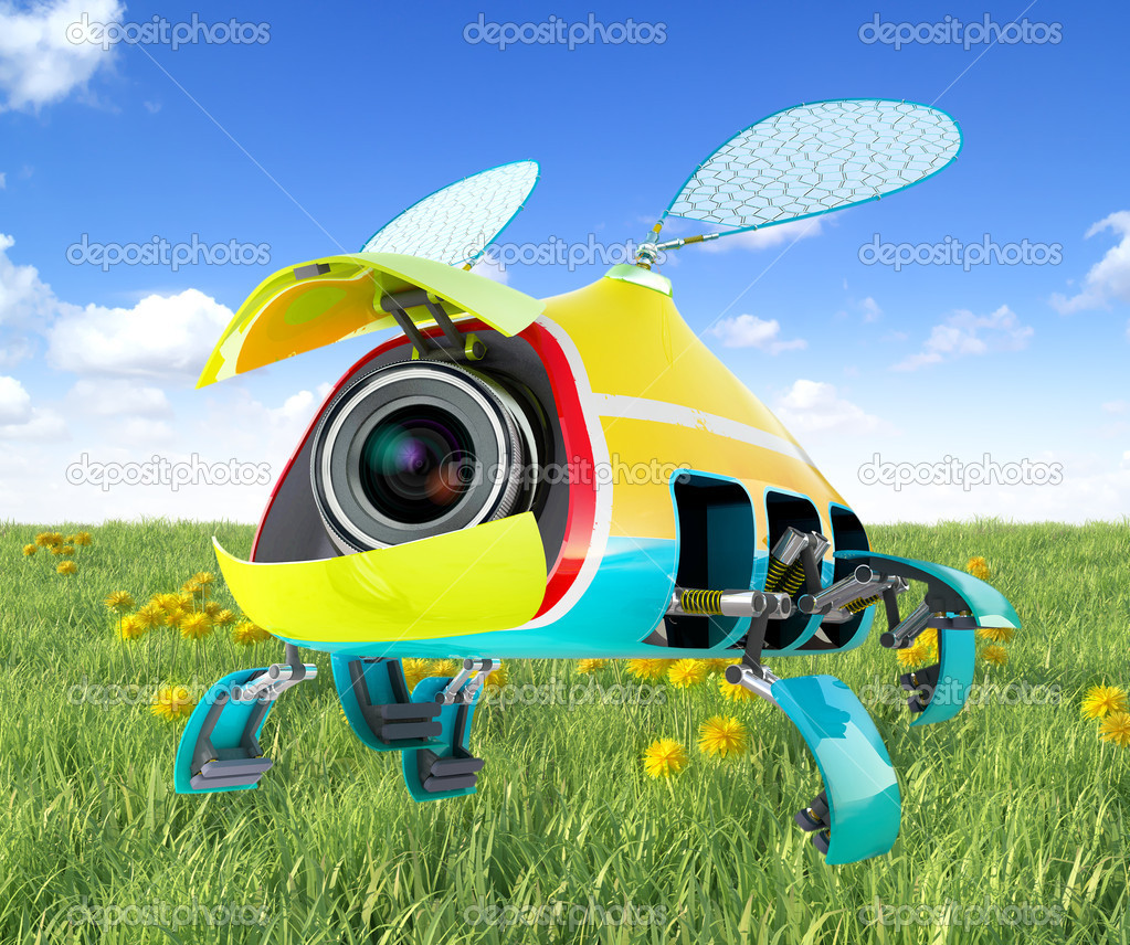 Security flay mini camera over green grass background