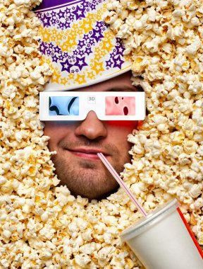 Happy face in popcorn with bucket on head watching 3D movie and drinking soda stock vector