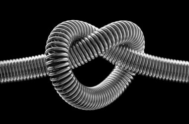 Knotted metal spring