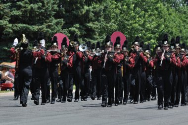 Dover-Eyota High School Marching Band Performing in a Parade