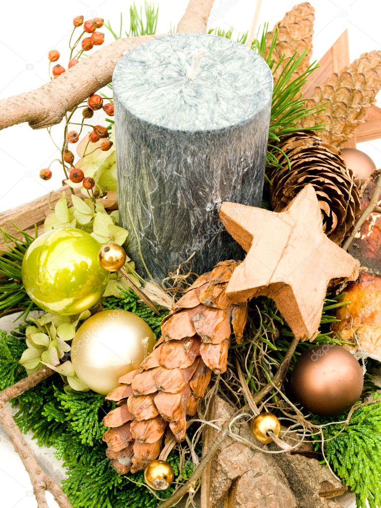 christmas arrangement with moss cones christmas decoration and big candle on white background photo by merial