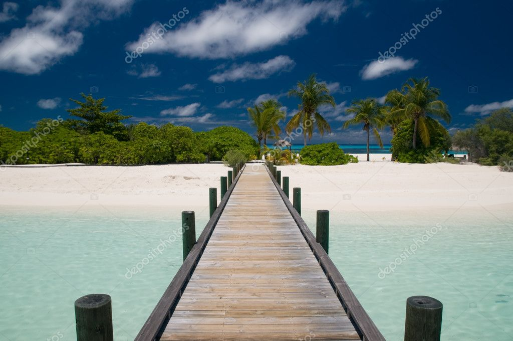 Jetty leading to a tropical island