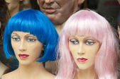 Two Mannikin heads with colorful wigs in a wig store