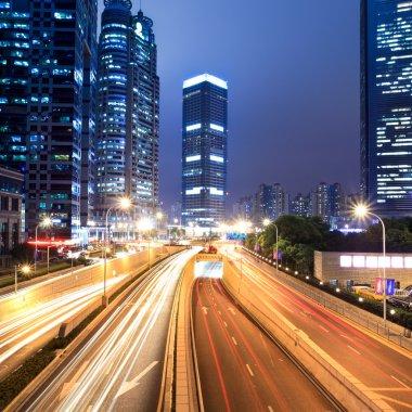 Light trails on shanghai financial center at night
