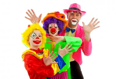 Three dressed up as colorful funny clowns