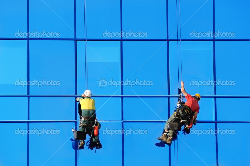 Two wahsers wash facade windows