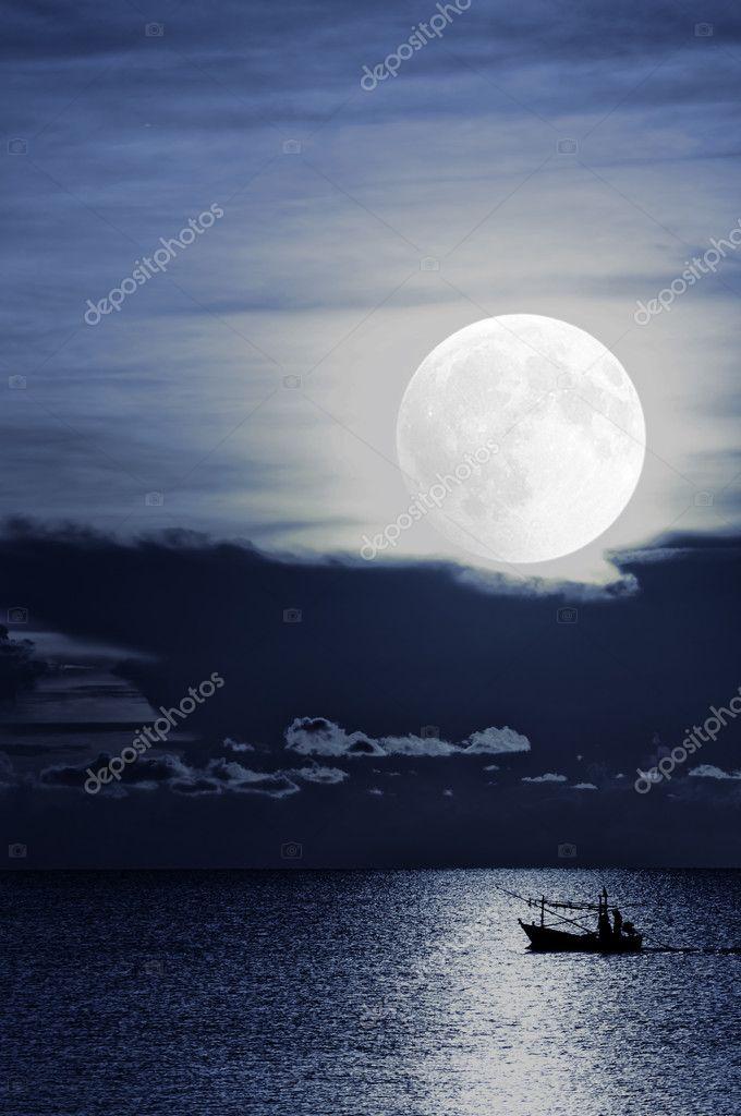 Moonlight fishing boat
