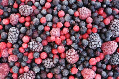 Close up of frozen mixed fruit - berries - red currant, cranberry, raspber