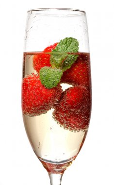 Glasses of sparkling wine and strawberry
