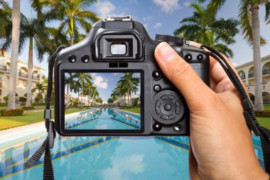 Camera in hand on tropical holidays