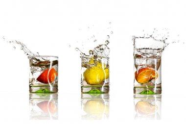 Drinks with splashing citrus fruits over white stock vector