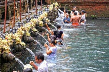 Prayers during purification at Puru Tirtha Empul temple, Bali