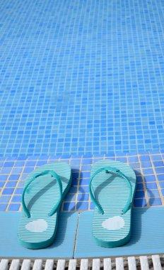 Blue flip flops near pool