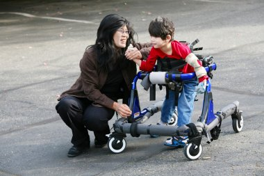 Mother with disabled son in walker