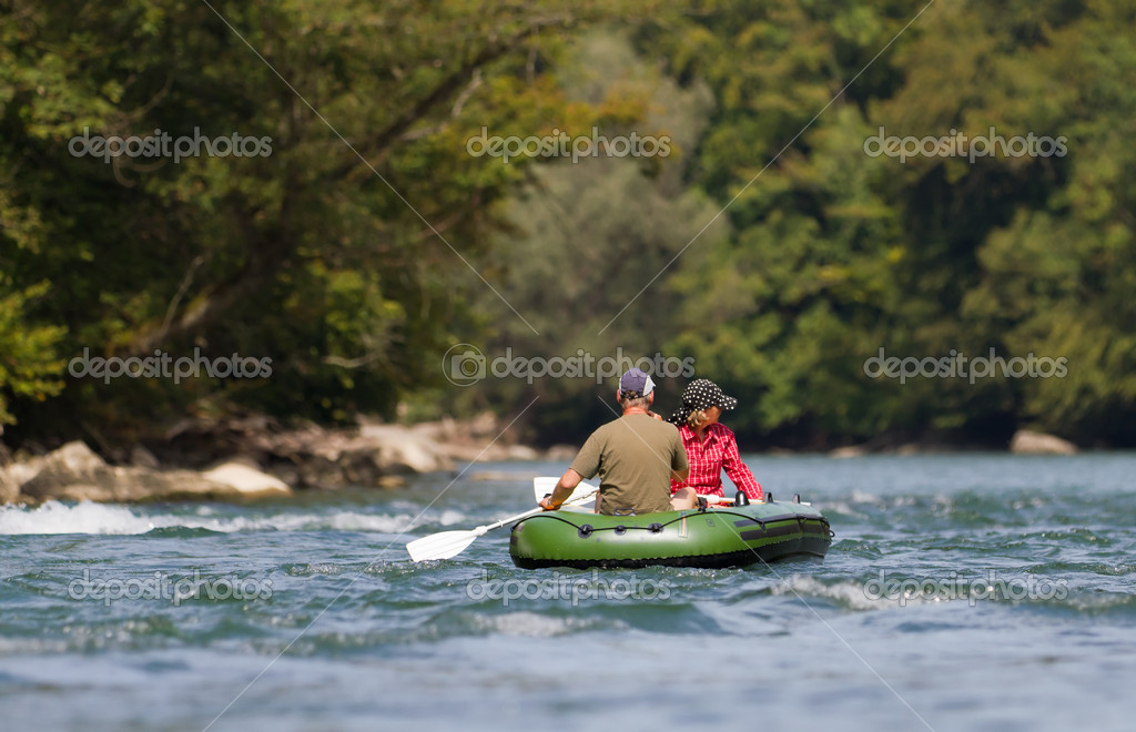 Middle aged couple rafting