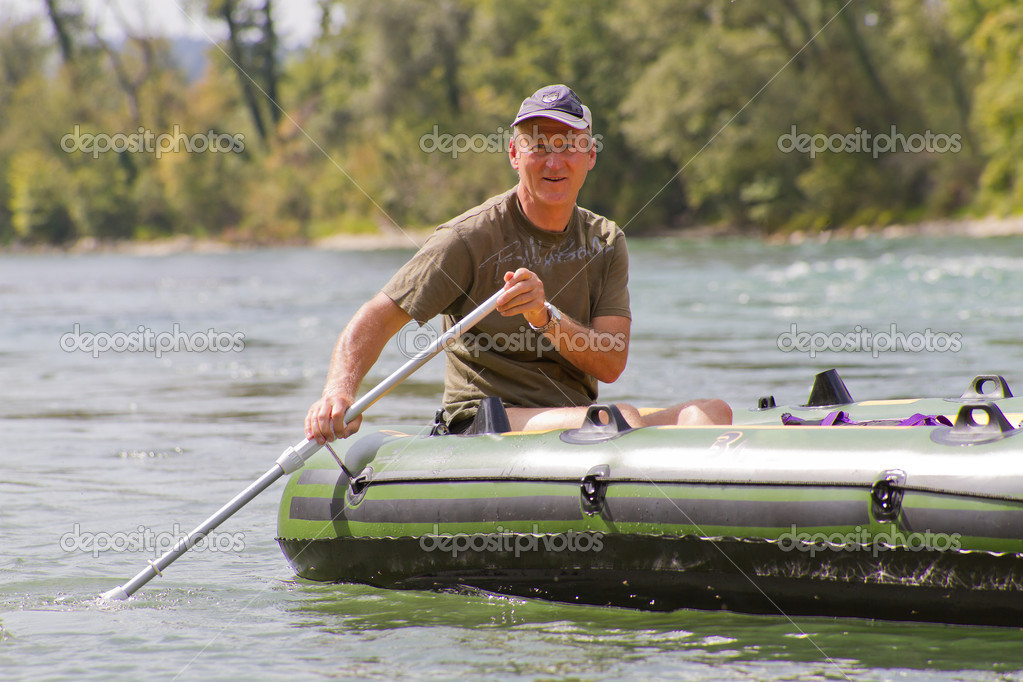 Middle aged man rafting