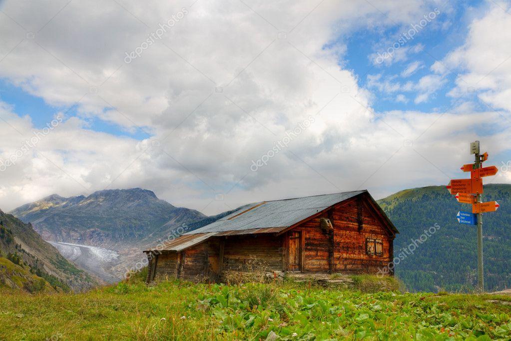 Aletsch glacier, hut and hiking signpost, Switzerland