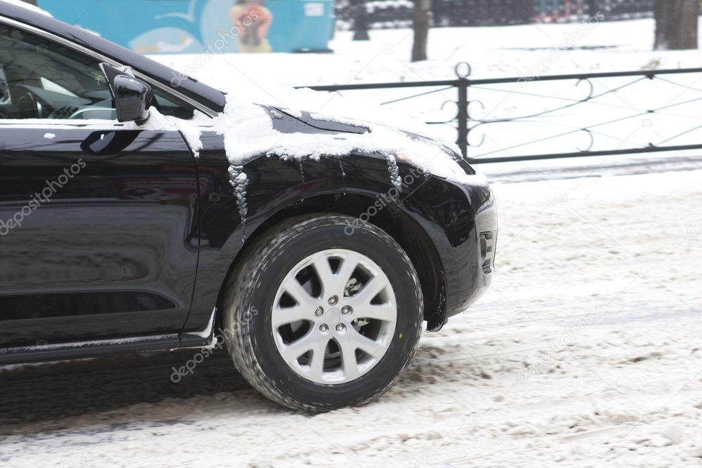 Car tires on a snowy road